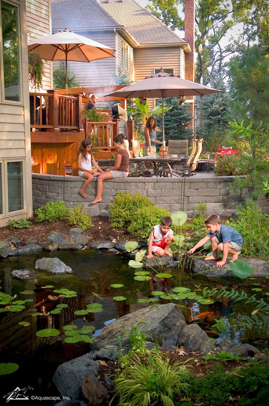 family enjoying water feature
